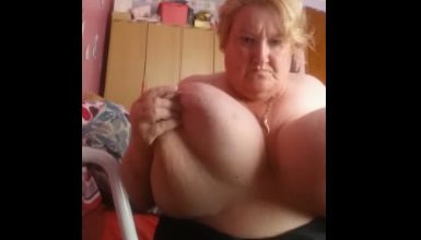Granny Gets Caught Playing With Her Massive Tits
